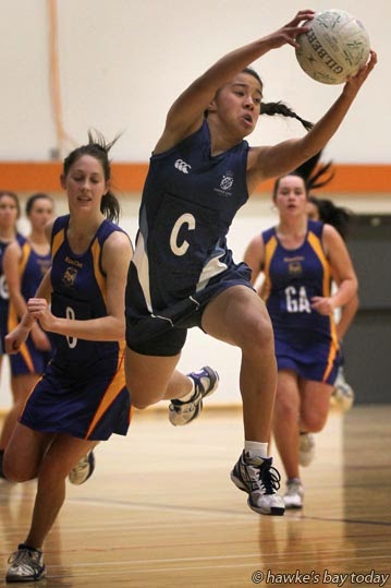 With ball: Briana Stephenson, centre, senior A netball team, Napier Girl's High School, Napier - netball vs Central Hawke's Bay College, at Pettigrew.Green Arena, Taradale, Napier photograph