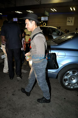 Aamir Khan leaves for US in his 'Dhoom 3' look