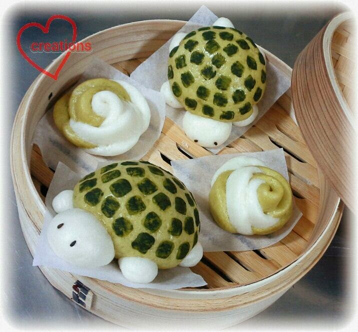 presenting my turtle baos with red bean filling and rose mantous i took the liberty of using green tea to add some natural coloring to the buns