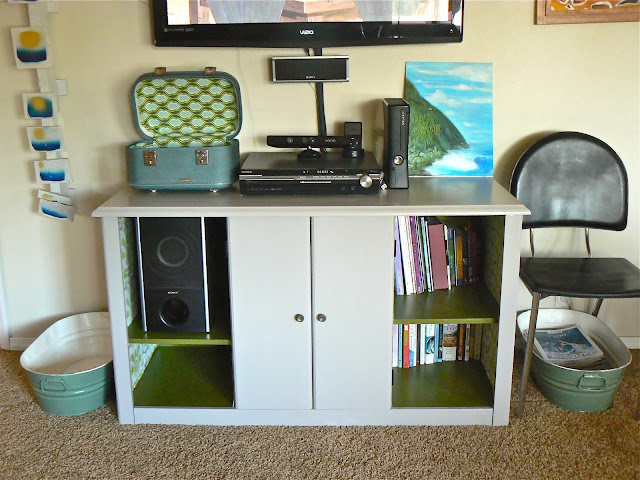 upcycled train case on entertainment center
