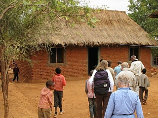 Foreigners enjoying hospitality in an african village after a tour