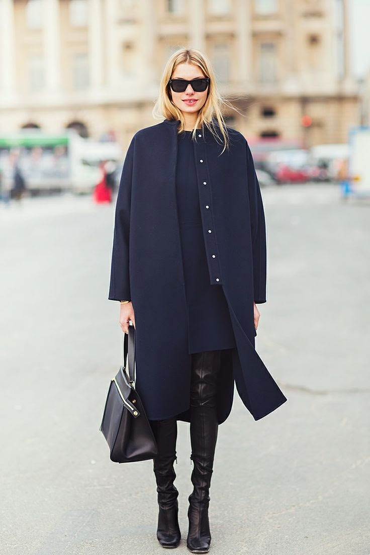 navy coat and black boots