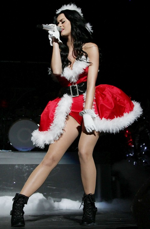 Perry showed off her arms and legs in a strapless fur-trimmed red bodysuit  with a puffy fur-trimmed skirt. Thesexy Santa outfit was completed with red  furry ... - Katy Perry's Christmas Costume - Sexy DAILY FASHION NEWS
