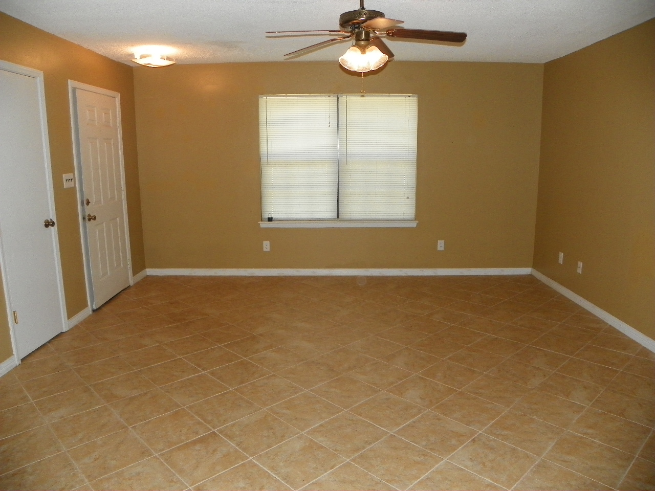 Love to live in pensacola florida 5 easy improvements for your pensacola property management ceiling fans and tiled floors in living room aloadofball Image collections