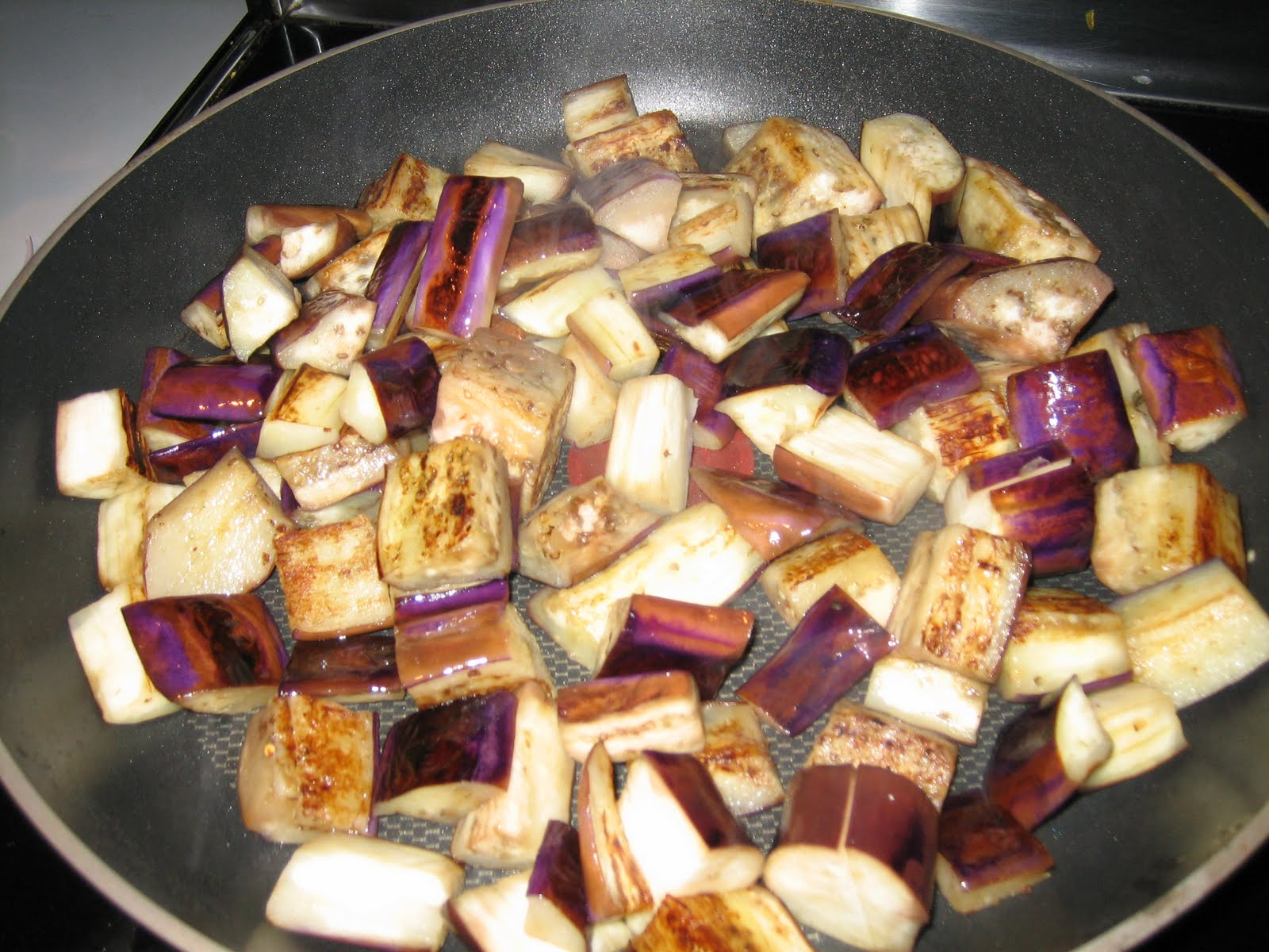 Saute Eggplant Pieces In A Large Skillet Till Lightly Roasted. Set Aside.