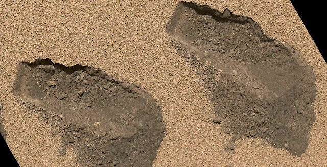 The Sample Analysis at Mars instrument suite found water in the dust, dirt and fine soil from the Rocknest site on Mars. (This file photo shows trenches Curiosity dug in October 2012.) Image Credit: NASA/JPL-Caltech/MSSS