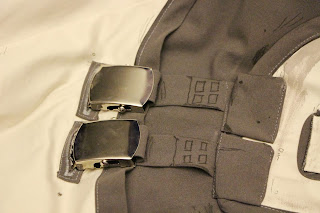 The back buckles on Dr. Zed's smock