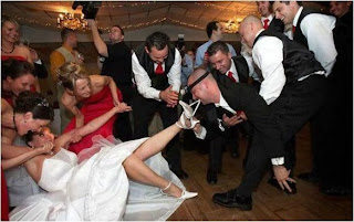 funny wedding picture: groom pull her panties off