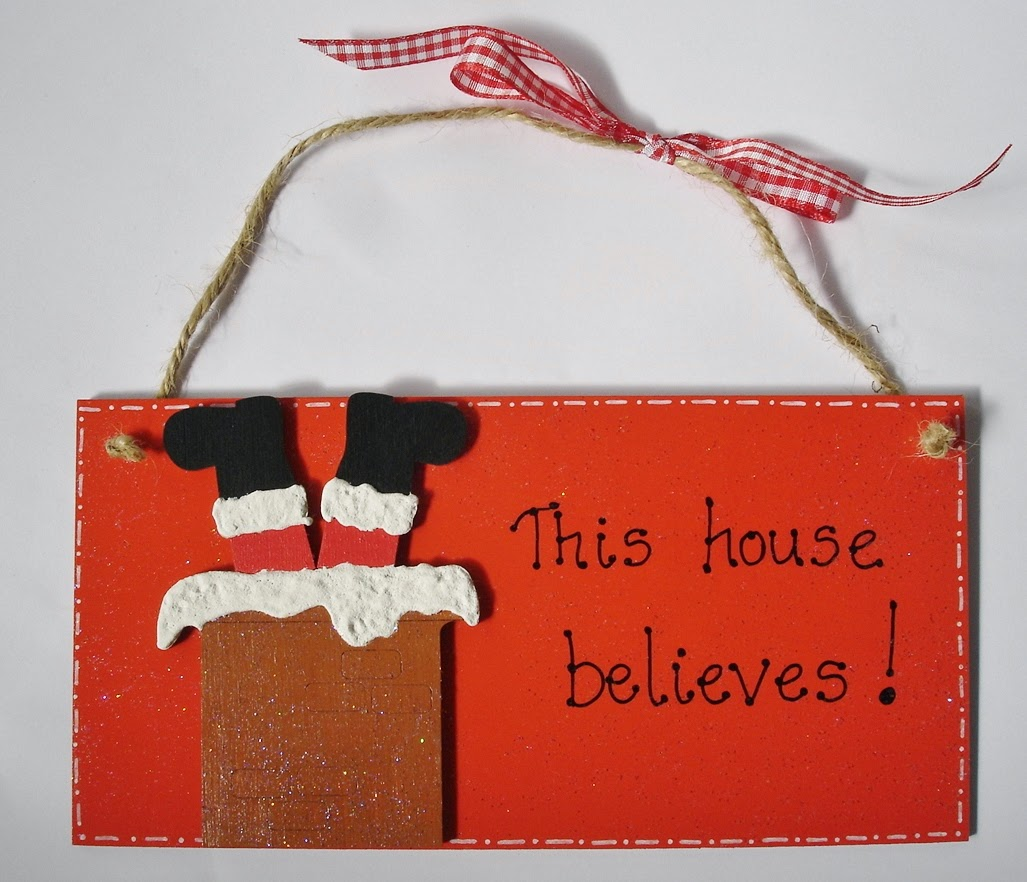 "Santa in chimney ""This house believes"" plaque"