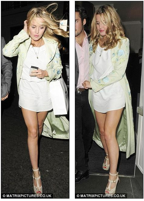 Windswept: Caggie Faced A Stiff Breeze In Her Little White Tunic