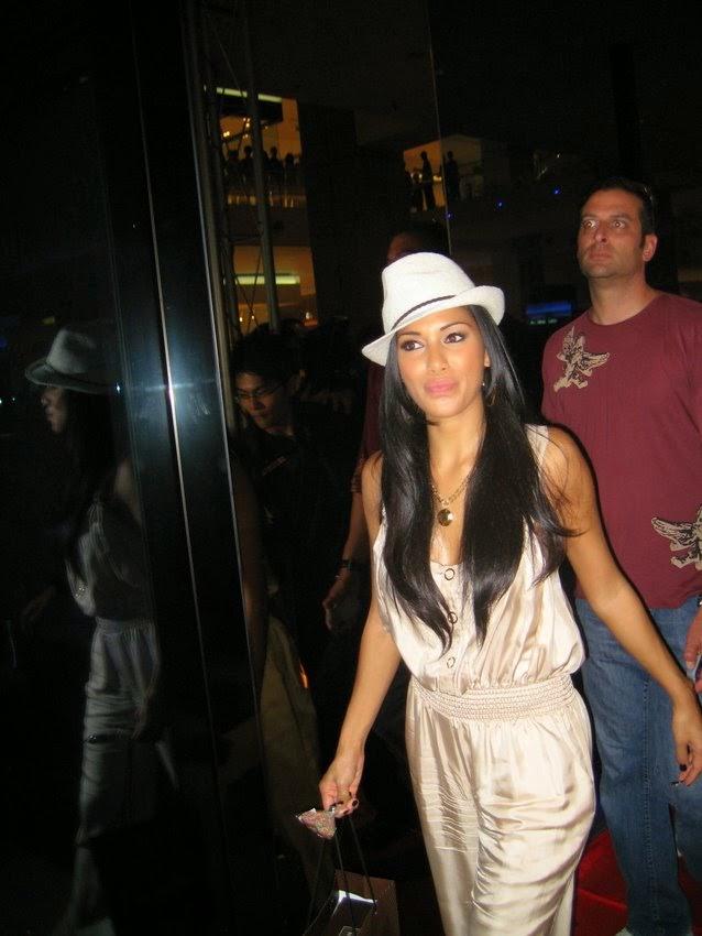 Nicole Scherzinger wearing a Jenny Dayco necklace