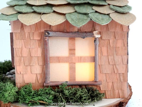 Rustic twig window casings on woodland house decor | popperandmimi.com