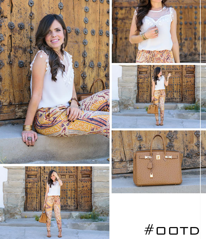 Look boho hippie con pantalones estampados de Zara, bolso Hermes y pulseras doradas