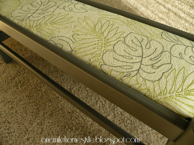 Gray bench with leaf fabric insert