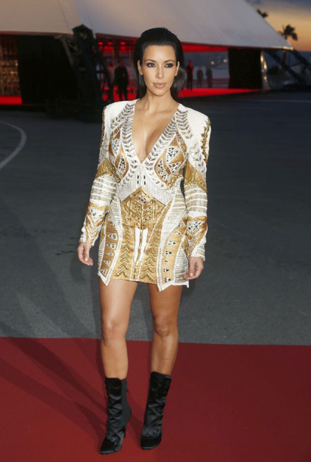 : kim kardashian with deep neck at premiere in cannes - cruel summer