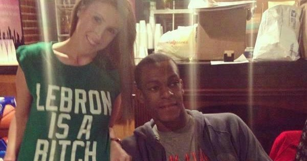 "with poses is T-shirt  Rondo girl a in ""Lebron B*@ch"""