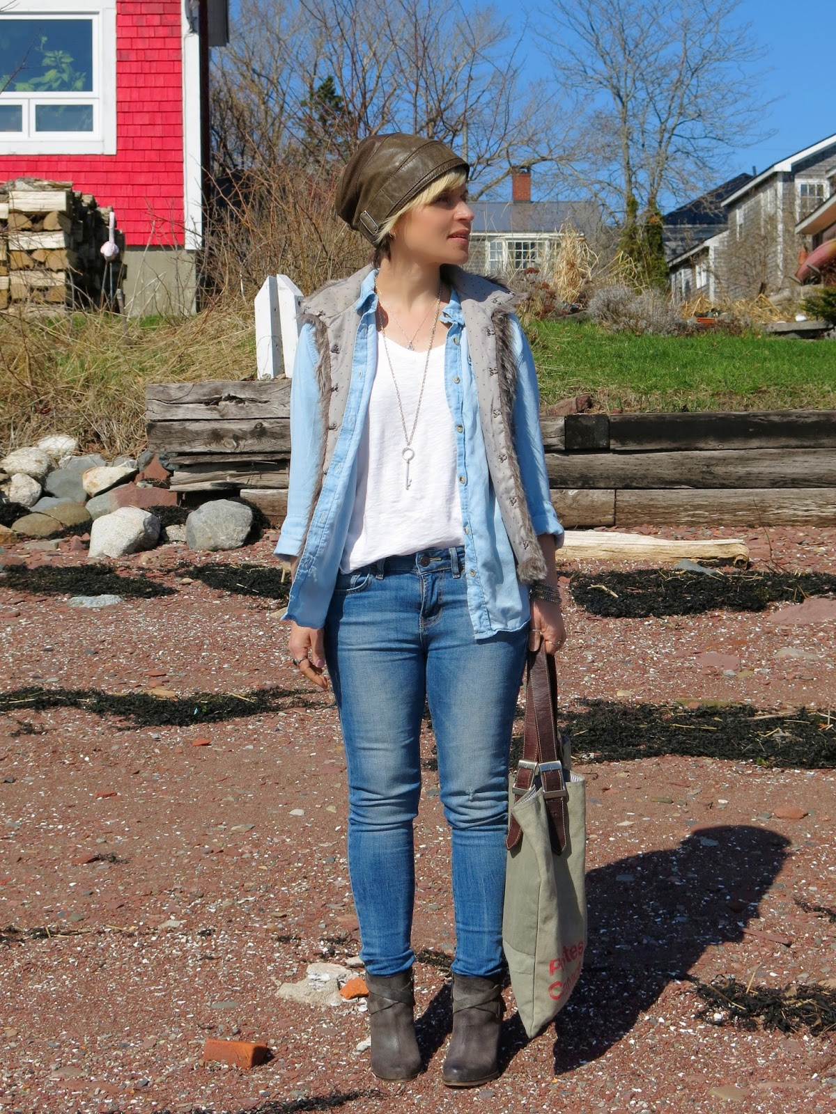 styling denim skinnies with white tee, chambray shirt, furry vest and leather beanie