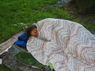 A homeless teenage girl sleeping in the open.
