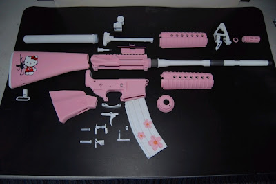 Hello Kitty pink AR-15 rifle gun parts taken apart