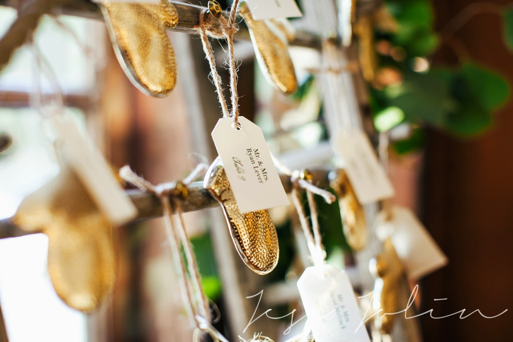 antique sleigh : winter wedding : escort card ideas : gold mittens : les fleurs : willowdale estate