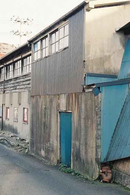old concrete buildings with blue zinc door