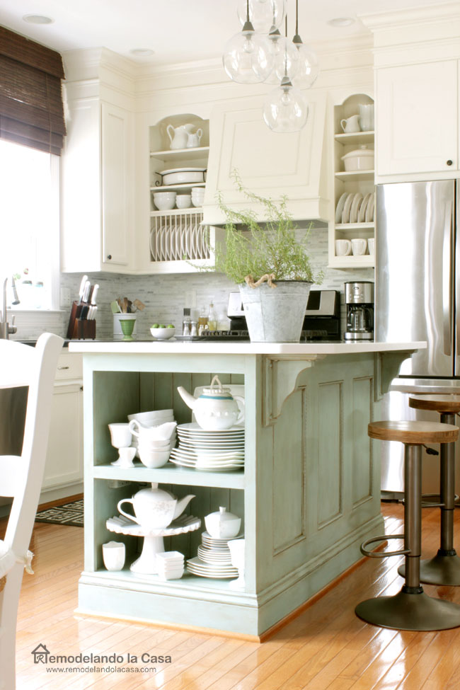 How to give your kitchen cabinets a custom look, white dishes on island and industrial bar stools