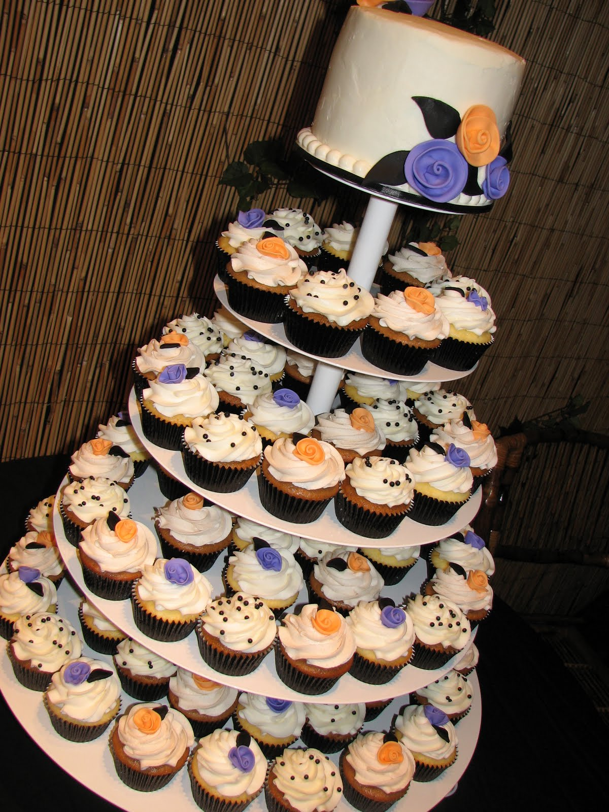 Decadent Designs Aubri s Purple & Orange Cupcake Wedding Cake