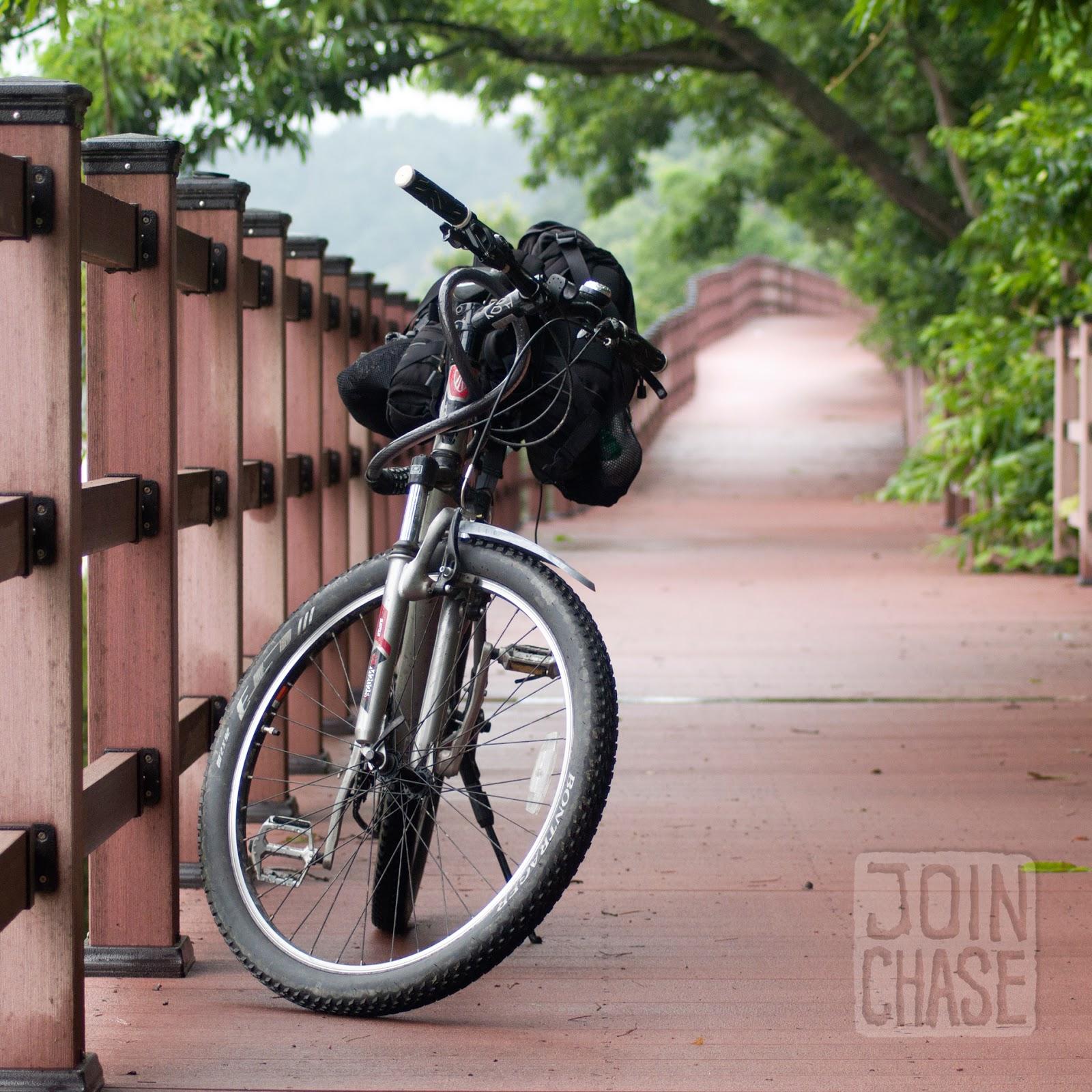 A bike on a wooden bridge along the Geum River Bike Path in South Korea.