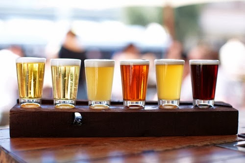Samples of beer in a glass.