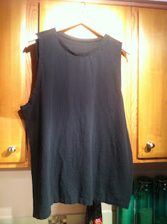 black crinkle cotton tank top on hangar.