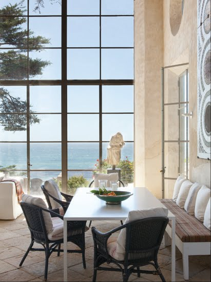 alternative view of the dining room that includes the ocean view through the encasement windows