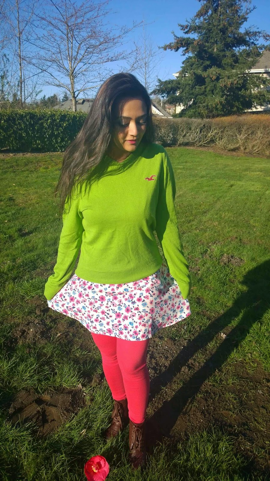 how to wear summer dress in winter, floral skater dress, layering of a dress, pink dress with green sweater