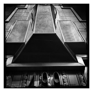 A black and white photo of a futuristic building facade in New York City