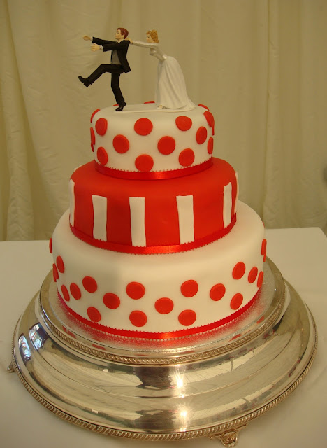 Red and white wedding cake with polka dots and stripes