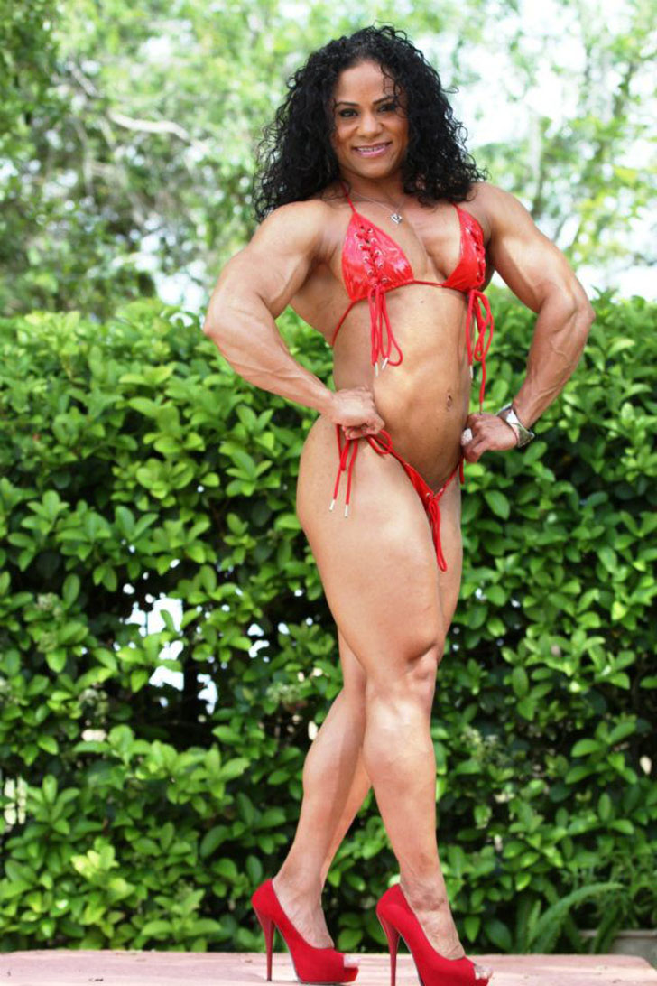 Kashma Maharaj Models Her Muscles In A Red Bikini And Heels