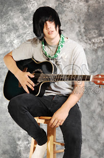 alone boy with guiter