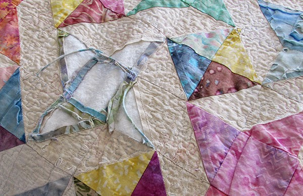 scrappy bed quilt, damaged