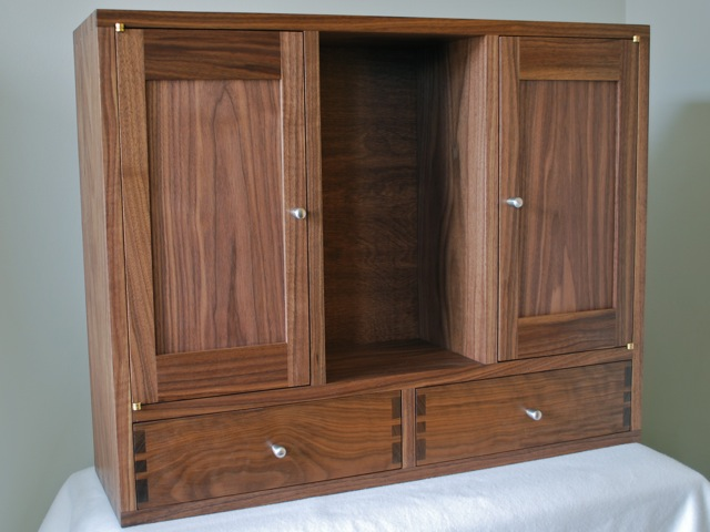 he built it out of walnut to match the bathroom vanity it has some