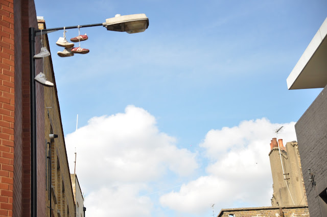 Shoreditch Chance Lane shoes hung on lamp post