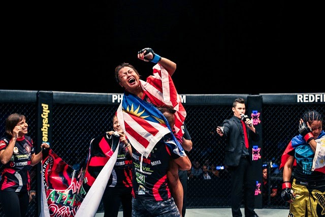 Ann Osman celebrates win against Ana Julaton in ONE FC 19 Reign of Champions