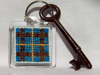 Teal, brown, and gold plaid cross stitched keychain