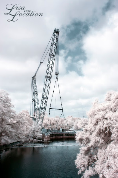 The 400-ton Submarine Theater is lifted out of Spring Lake at Aquarena Center, Texas State University-San Marcos. Infrared photo by Lisa On Location photography.