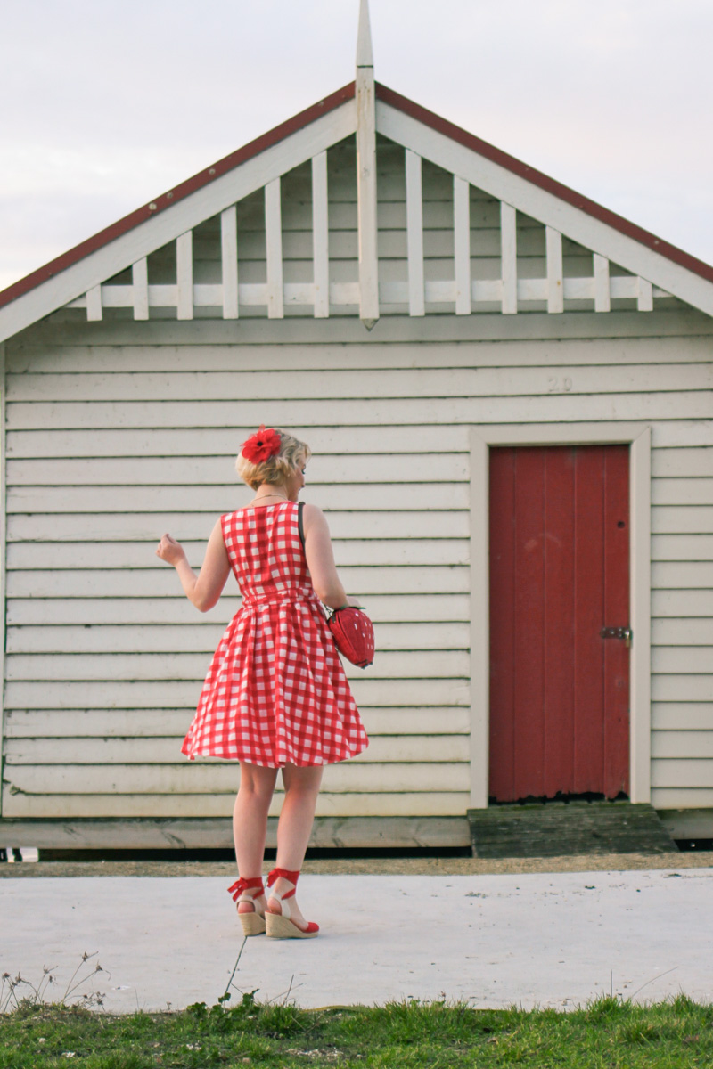 @findingfemme wears red gingham Alannah Hill dress, red Modcloth wedges and red strawberry bag.