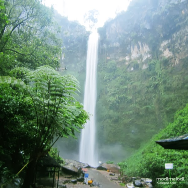 Against The Rain in Coban Rondo Waterfall, Malang - NONIQ | A Review on