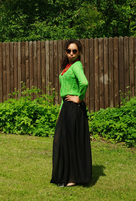 Black maxi skirt and green jumper
