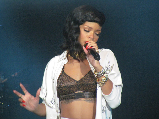 Rihanna performing in London on 777 tour, tattoo and leopard print bra