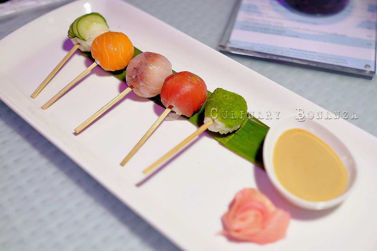 BLU Sushi Bubbles - a platter of sushi balls on a stick with various fresh sashimi, such as tuna, salmon, snapper, tobiko and kyuri, served with yuzu soy dip.
