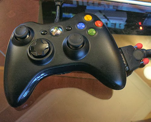 Tentacular (OneSwitch.org.uk adapted Xbox 360 joypad). Black with an attached VGA cable.
