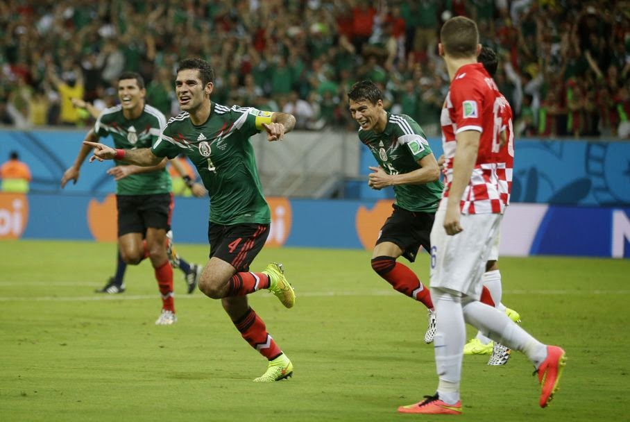 Mexico's Rafael Marquez celebrates after scoring the first goal of his team during the group A World Cup soccer match between Croatia and Mexico at the Arena Pernambuco in Recife, Brazil, Monday, June 23, 2014. Mexico won 3-1.