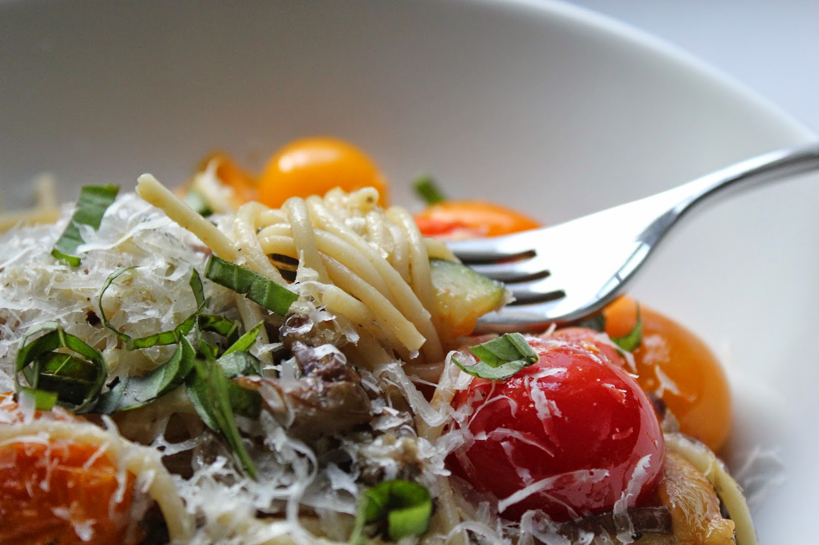 Pasta with summer vegetables, garlic, and basil